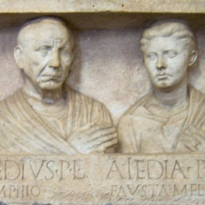 "A successful freedman, like Hermas, with his young wife. (""Grave relief of Publius Aiedius and Aiedia,"" detail from a picture taken by Marcus Cyron - Own work, CC BY-SA 3.0 - from Wikimedia Commons)"