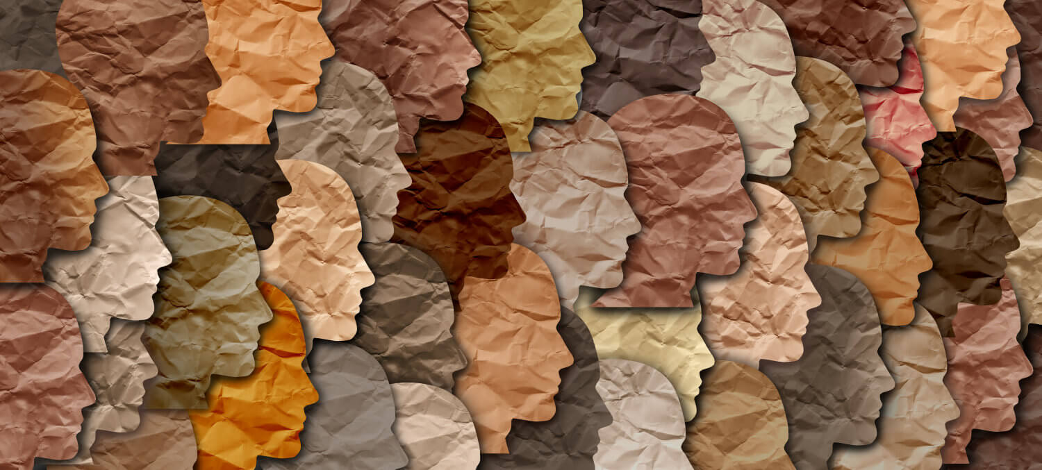 A collage of faces in all shades of brown, beige, and black