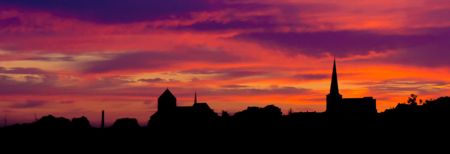A Church on the Horizon at Sunset