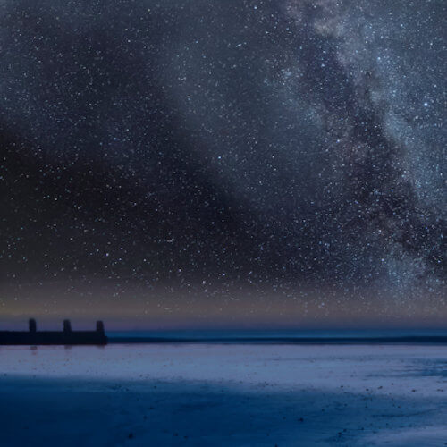 A view of the ocean and the Milky Way