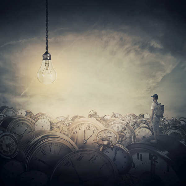Illustration of a person standing on a pile of clocks looking at a big light bulb