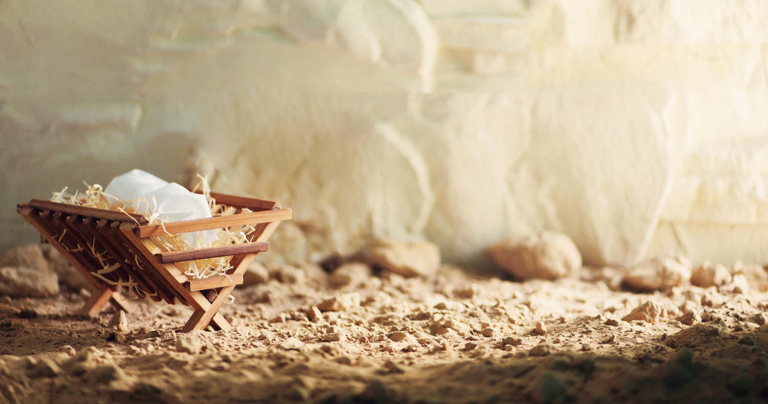 A photo of a manger against an abstract background