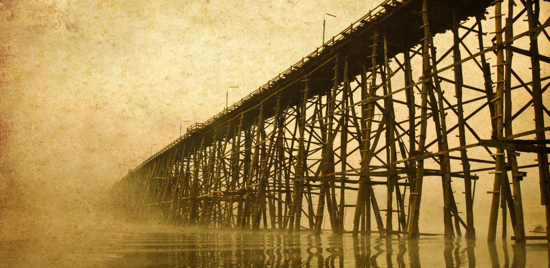 A long wooden bridge over water